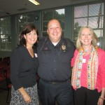 Nancy Longman, Brimfield Police Chief David Oliver, and Christine Bretz